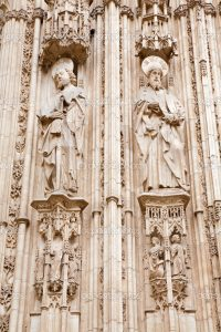 TOLEDO - MARCH 8: Apostle Paul and Jacob from south gothic portal of Cathedral Primada Santa Maria de Toledo on March 8, 2013 in Toledo, Spain.